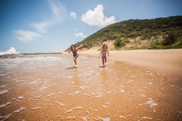 Children on the beach at Makakatana Bay Lodge