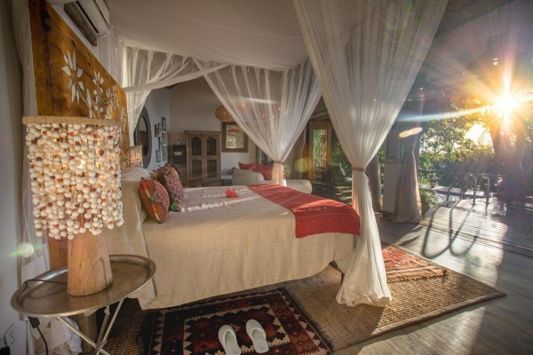 View from the 4-poster bed at The Bird House at Tongabezi Lodge
