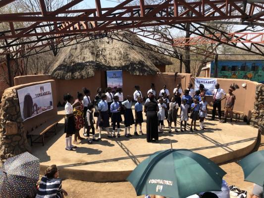 Tujatane choir singing in ampitheatre